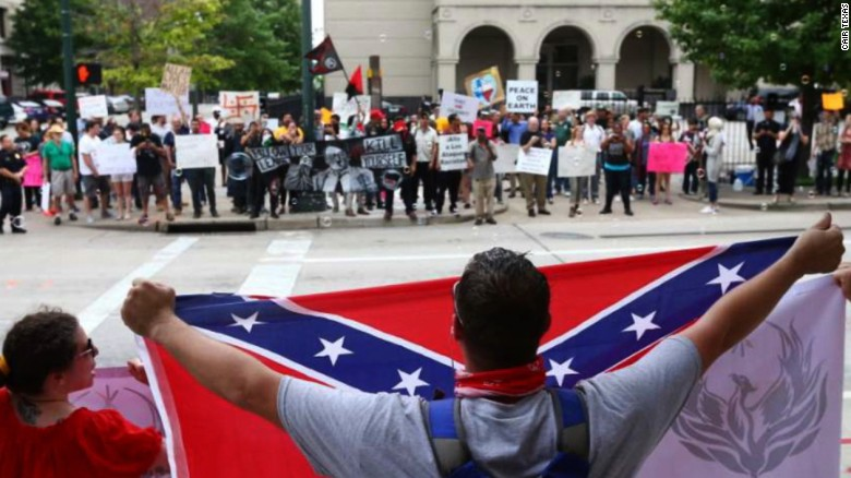 """Demonstrators and counter-protestors gather at the so-called """"Stop Islamization of Texas"""" rally, an event organized on Facebook by a Russian-linked page"""