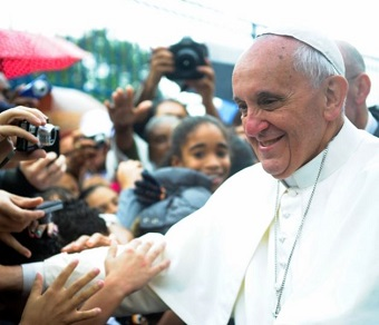 Pope Francis shakes hands with admirers during World Youth Day 2013.