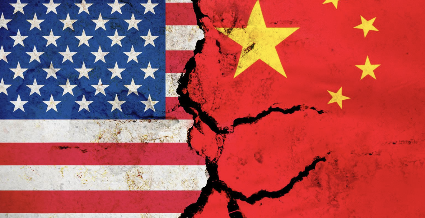 A flag of China on the right and a flag of the U.S on the left with cracks appearing at the point of cotact