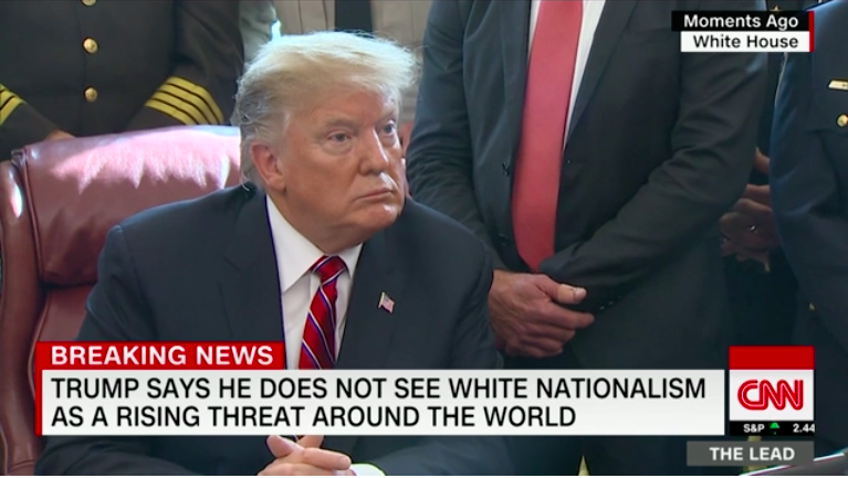"Screenshot of President Trump during a press conference in March 2019 from the White House. The chyron text reads: ""Trump says he does not see white nationalism as a rising threat around the world."""