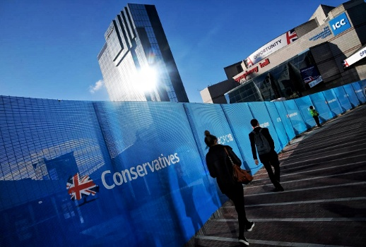 "Two figures walk up steps bordered by the British flag that says ""Conservatives"""