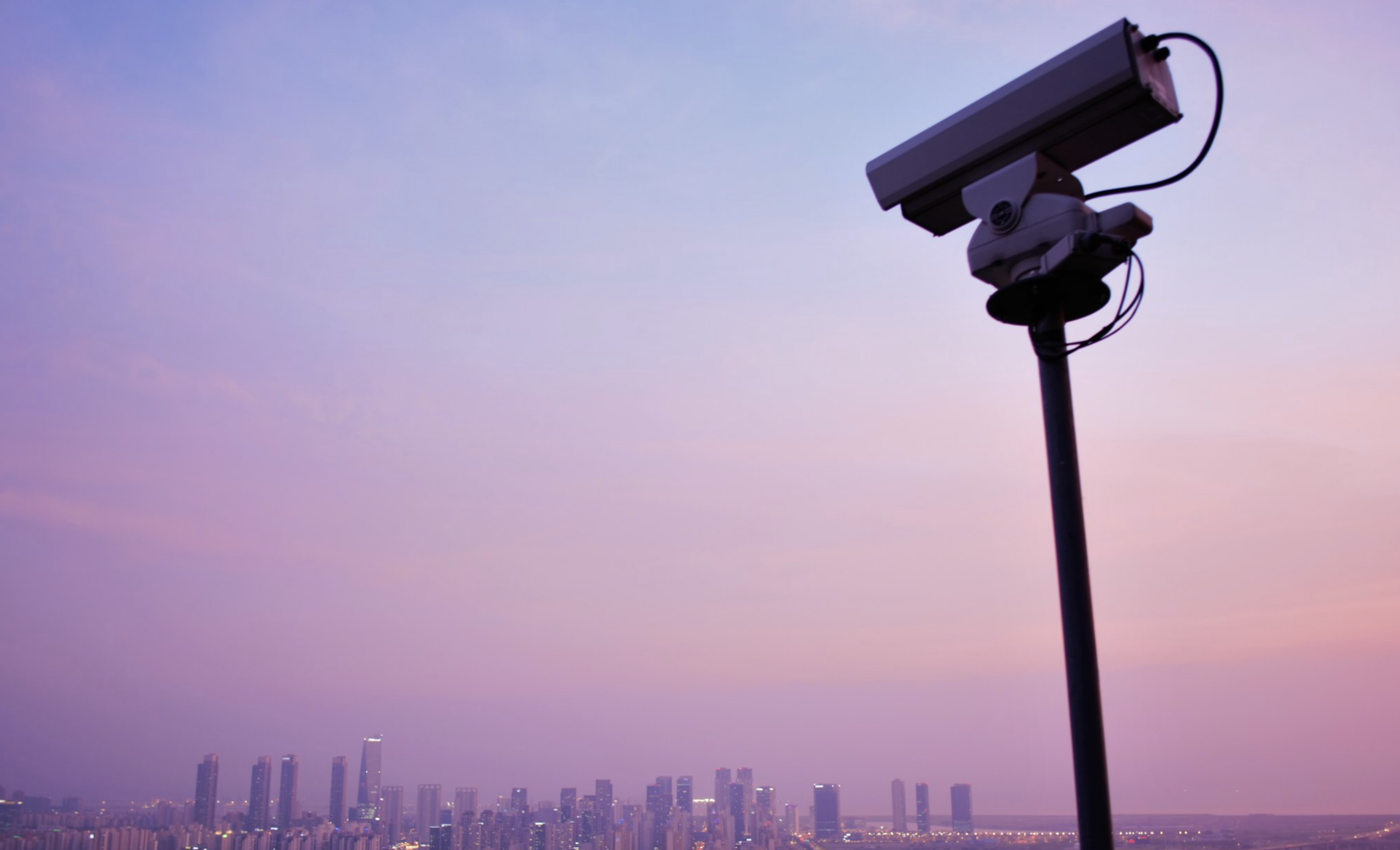 A CCTV camera looks at a city in the distance