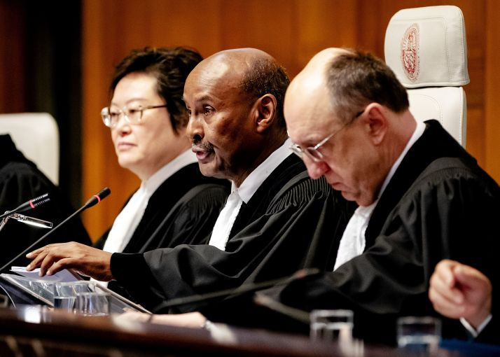 """President of the International Court of Justice, Abdulqawi Ahmed Yusuf (C) speaks during the ruling of the International Court of Justice in The Hague, on January 23, 2020 in the lawsuit filed by The Gambia against Myanmar in which Myanmar is accused of genocide against Rohingya Muslims. - The UN's top court ordered Myanmar on January 23 to take """"all measures within its power"""" to prevent alleged genocide against Rohingya Muslims. The International Court of Justice granted a series of emergency steps requested by the mainly Muslim African state of The Gambia under the 1948 Genocide Convention. (Photo by Robin VAN LONKHUIJSEN / ANP / AFP) / Netherlands OUT (Photo by ROBIN VAN LONKHUIJSEN/ANP/AFP via Getty Images)"""