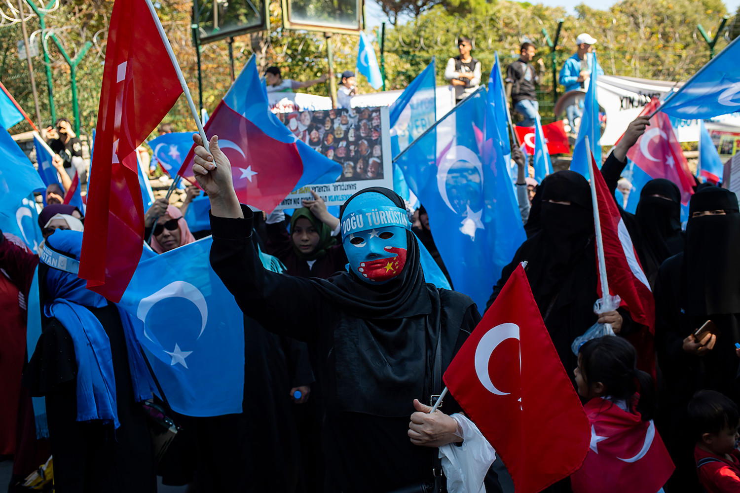 Supporters of China's Muslim Uighur minority and Turkish nationalists wave the flag of East Turkestan during an anti-China protest in front of the Chinese consulate in Istanbul on October 1, 2019, on the 70th anniversary of the founding of The People's Republic of China. (Photo by Yasin AKGUL / AFP) (Photo credit should read YASIN AKGUL/AFP via Getty Images)